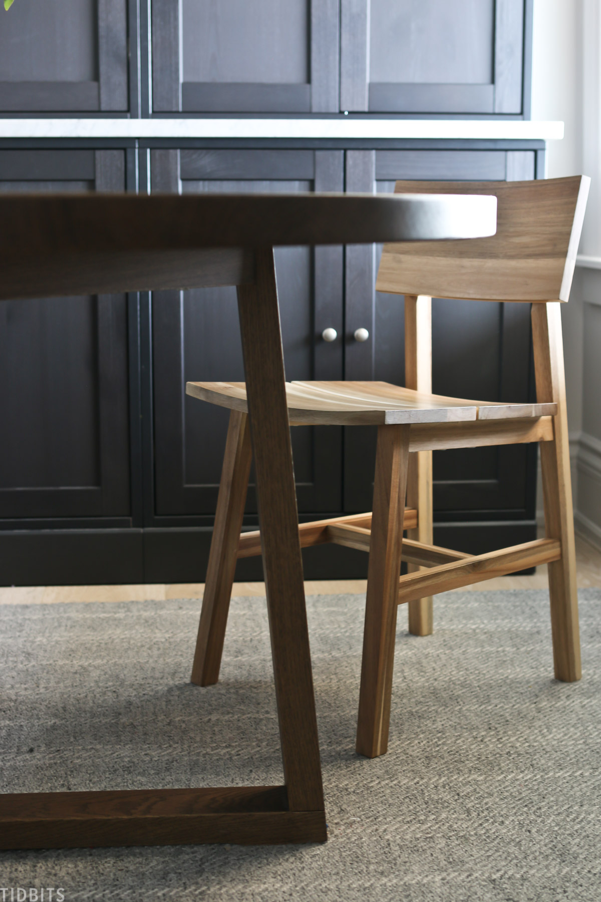 wooden chair placed next to roundtable