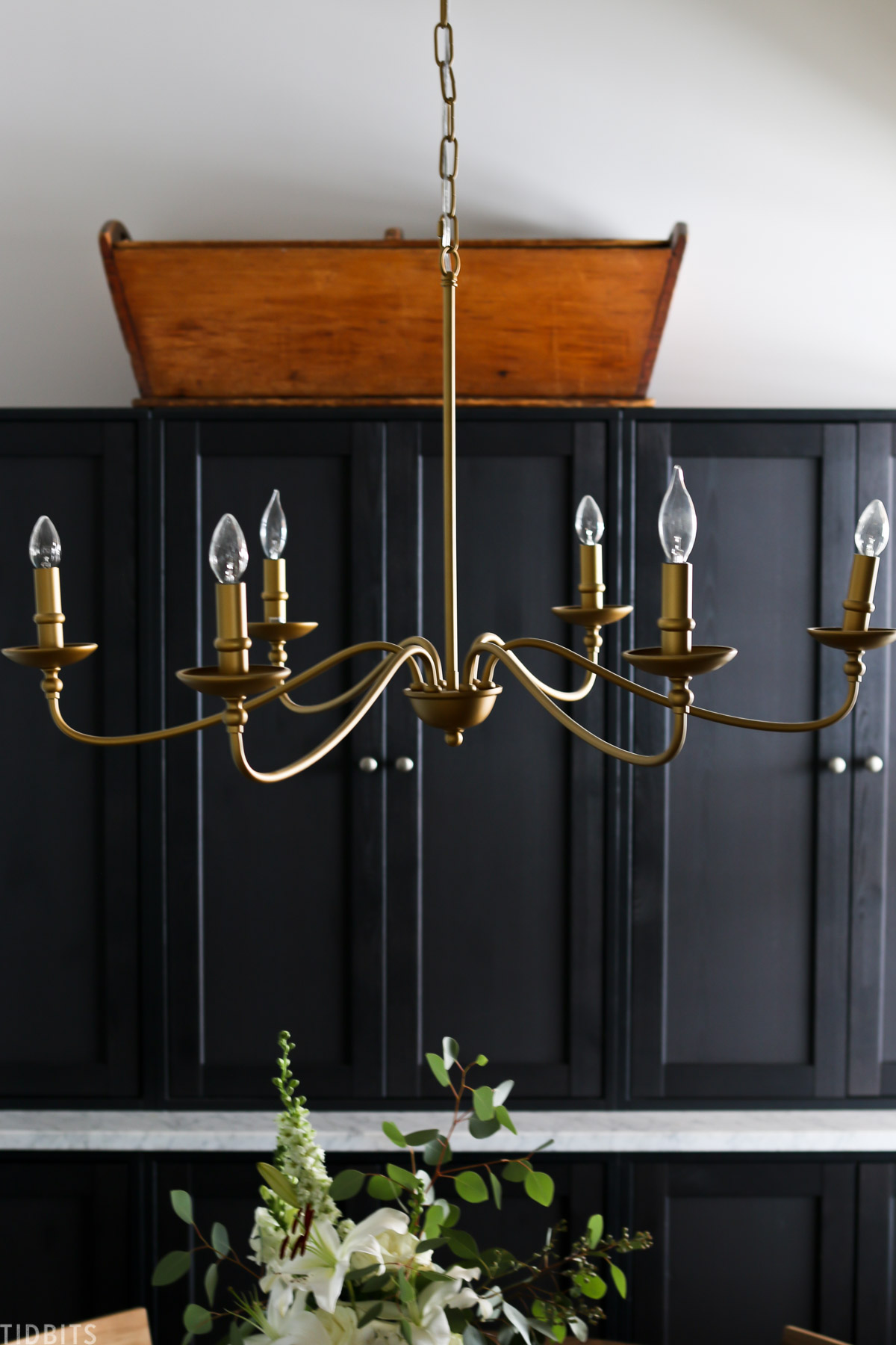 chandelier hanging in homeschool room with havsta cabinets and dough trough in the background
