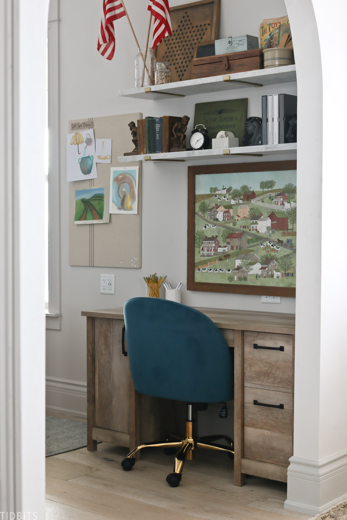blue chair and desk in a homeschool room with floating shelves installed above it