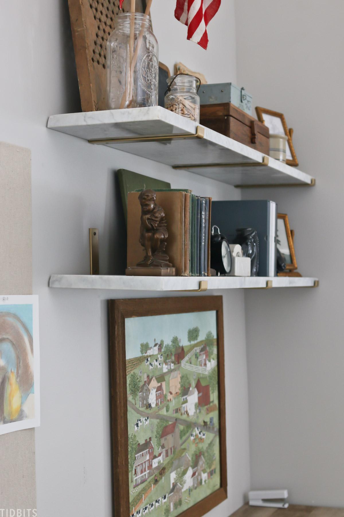 Bookends holding up a bookshelf on a floating shelf