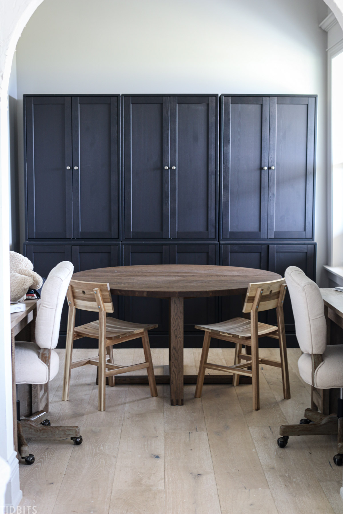 office space with two desks, a round table and chair and black Havsta cabinets