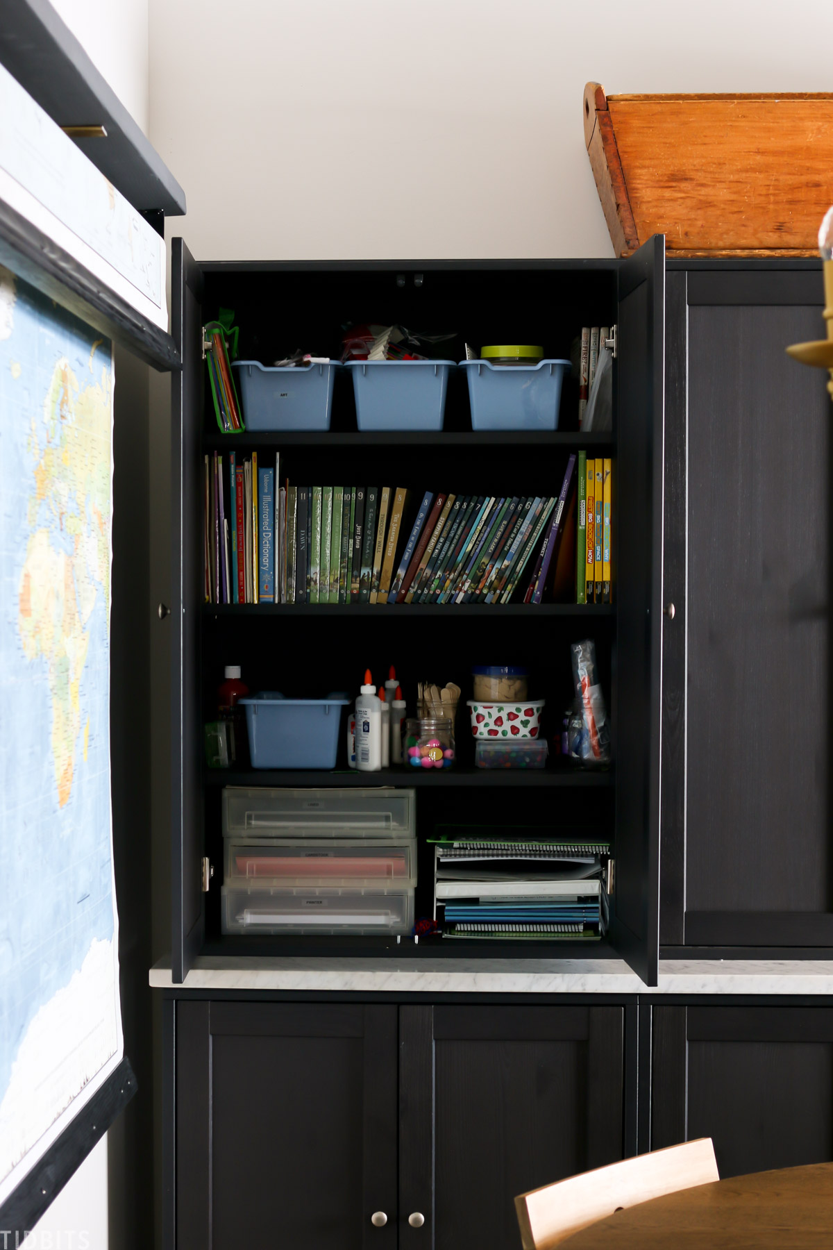 Havsta storage cabinets with school supplies inside one of the cabinets