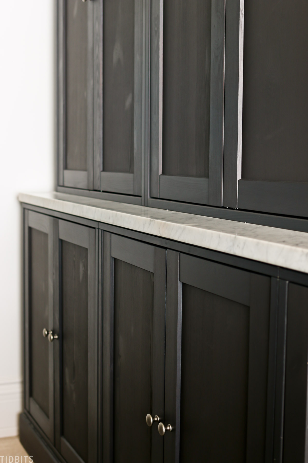 black Havsta cabinets made by IKEA