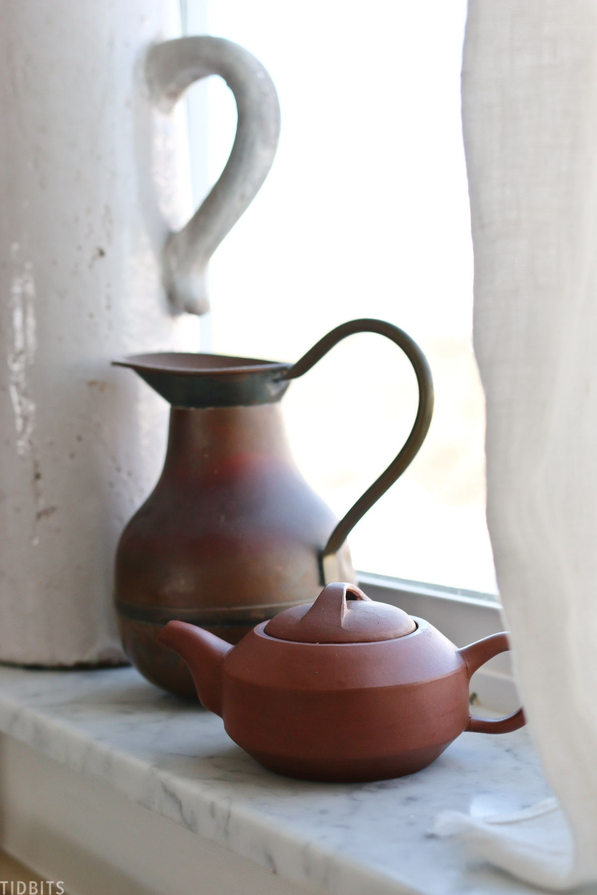 pottery Chinese tea pot sitting on windowsill