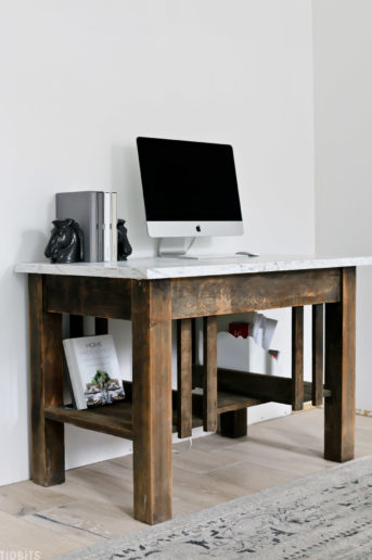 old antique desk with a computer on top with planners and bookkends