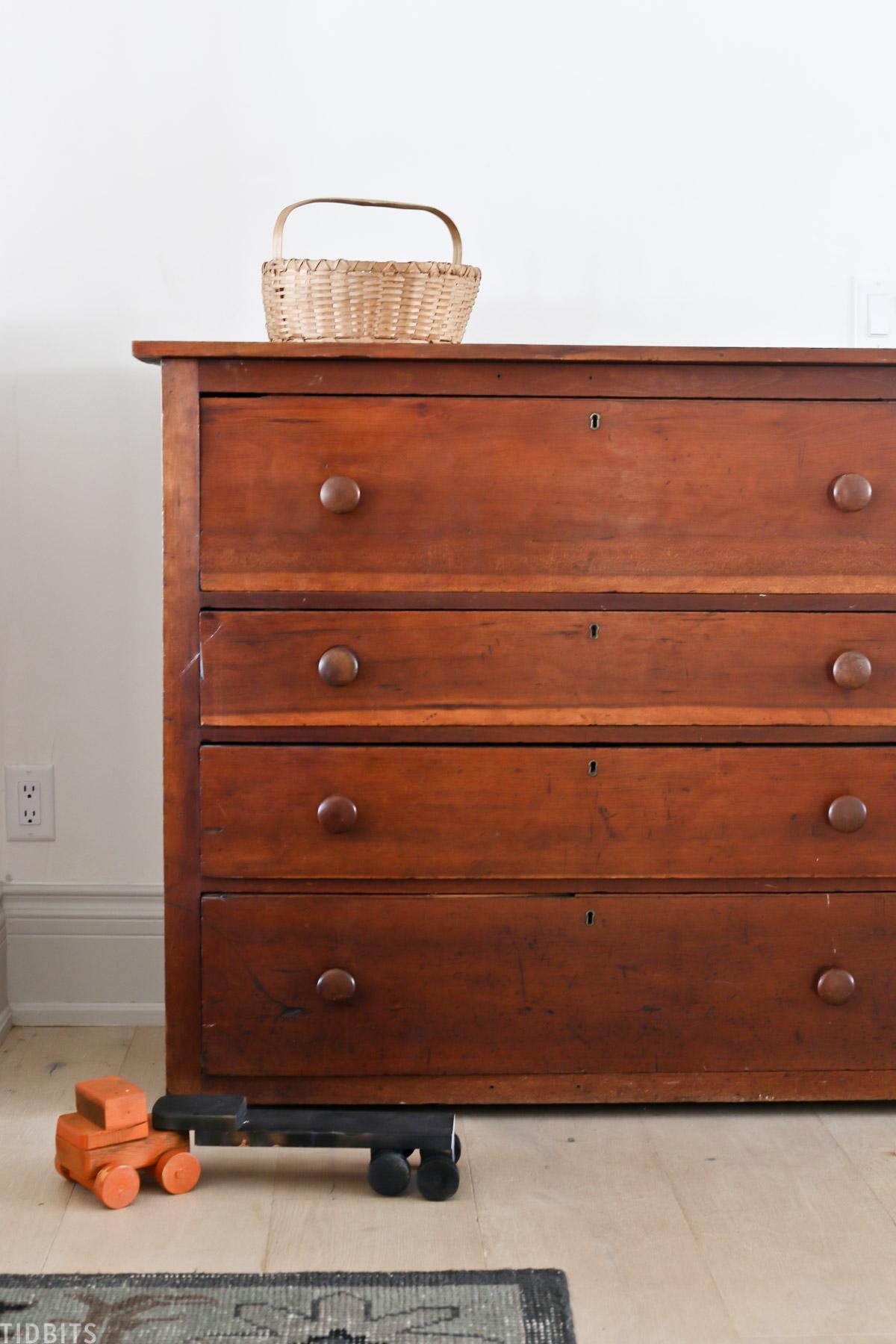 basket placed on top of antique dresser