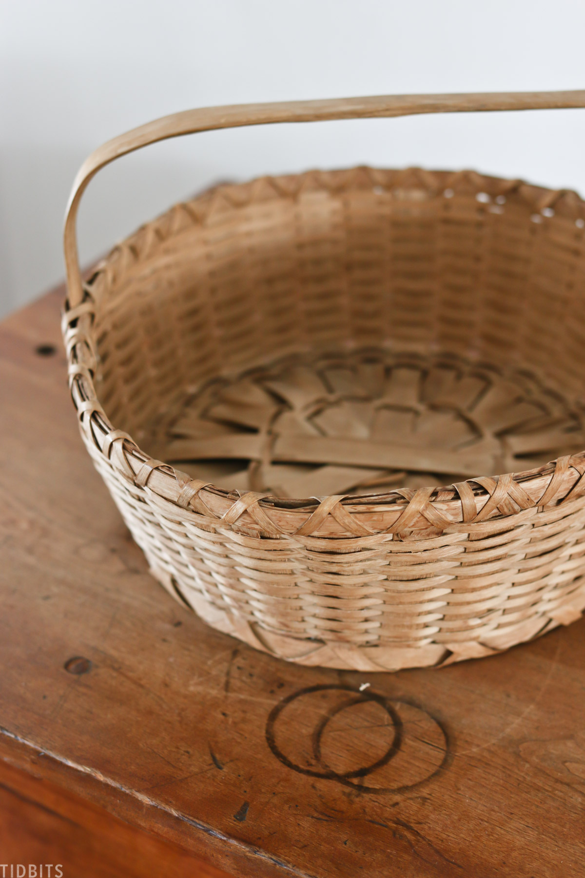 antique woven basket placed on top of dresser
