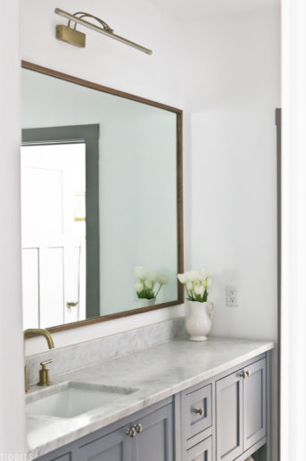 DIY mirror frame above bathroom vanity
