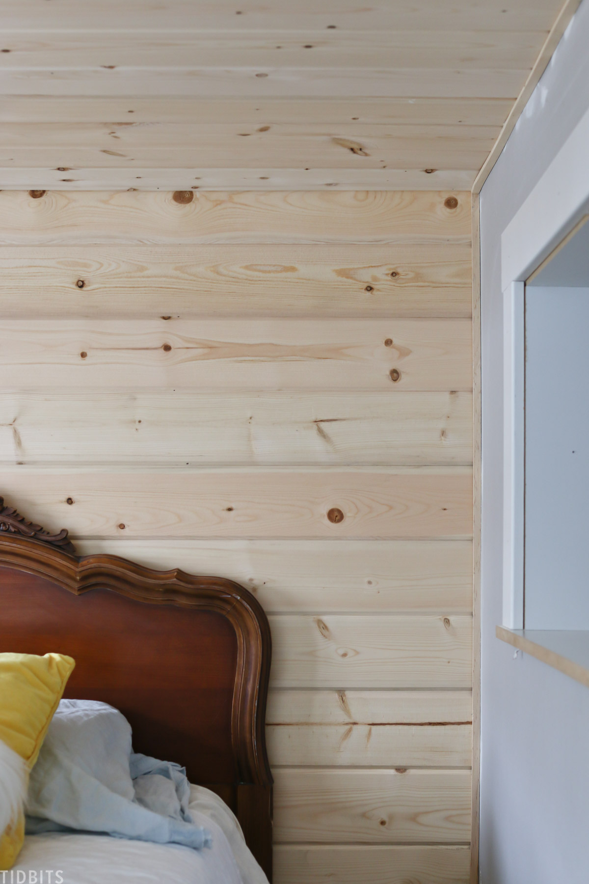 hardwood installed on the wall in kids' bedroom
