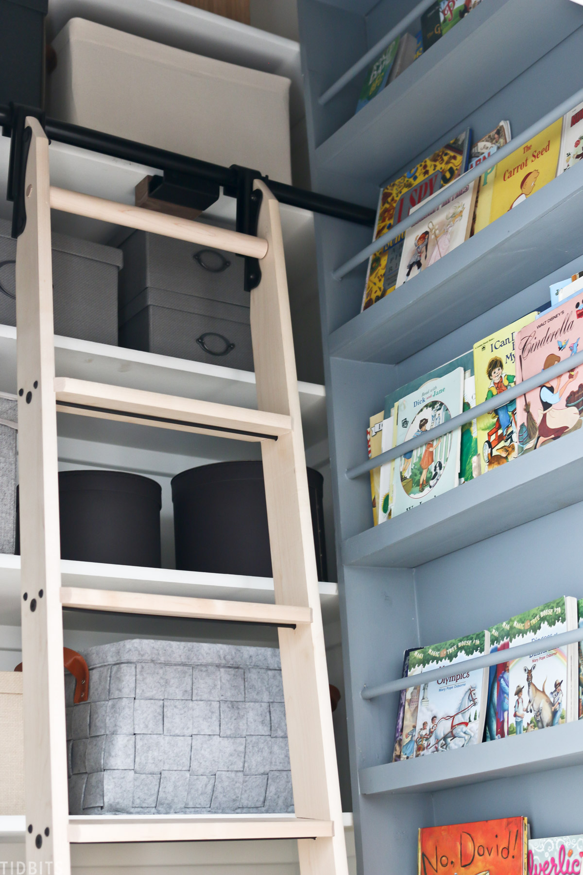 rolling ladder that's connected to a shelf in a walk in closet