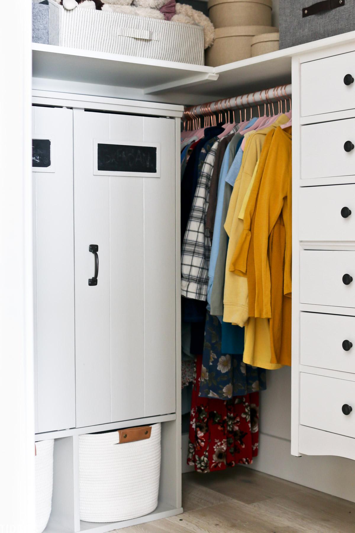 cupboards installed in a walk in kids closet