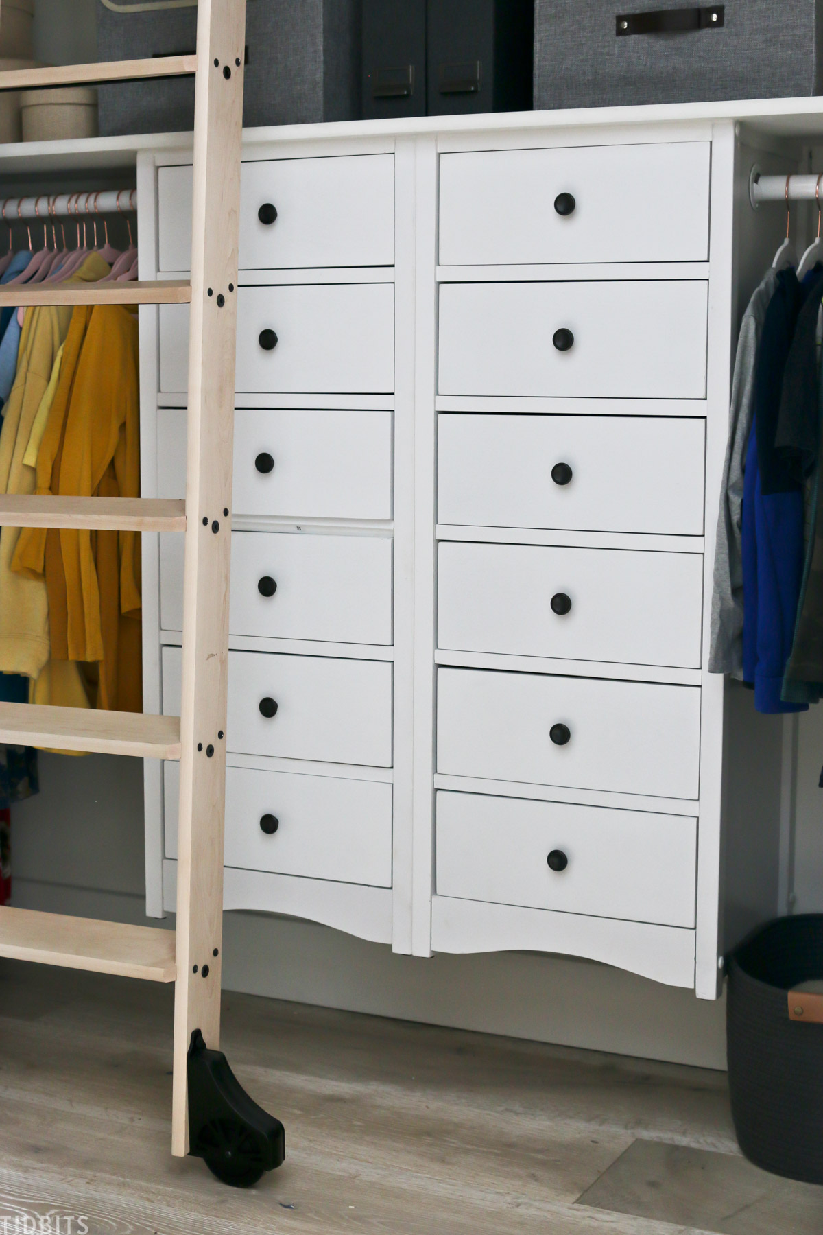 two tall, white dressers installed in a walk in closet