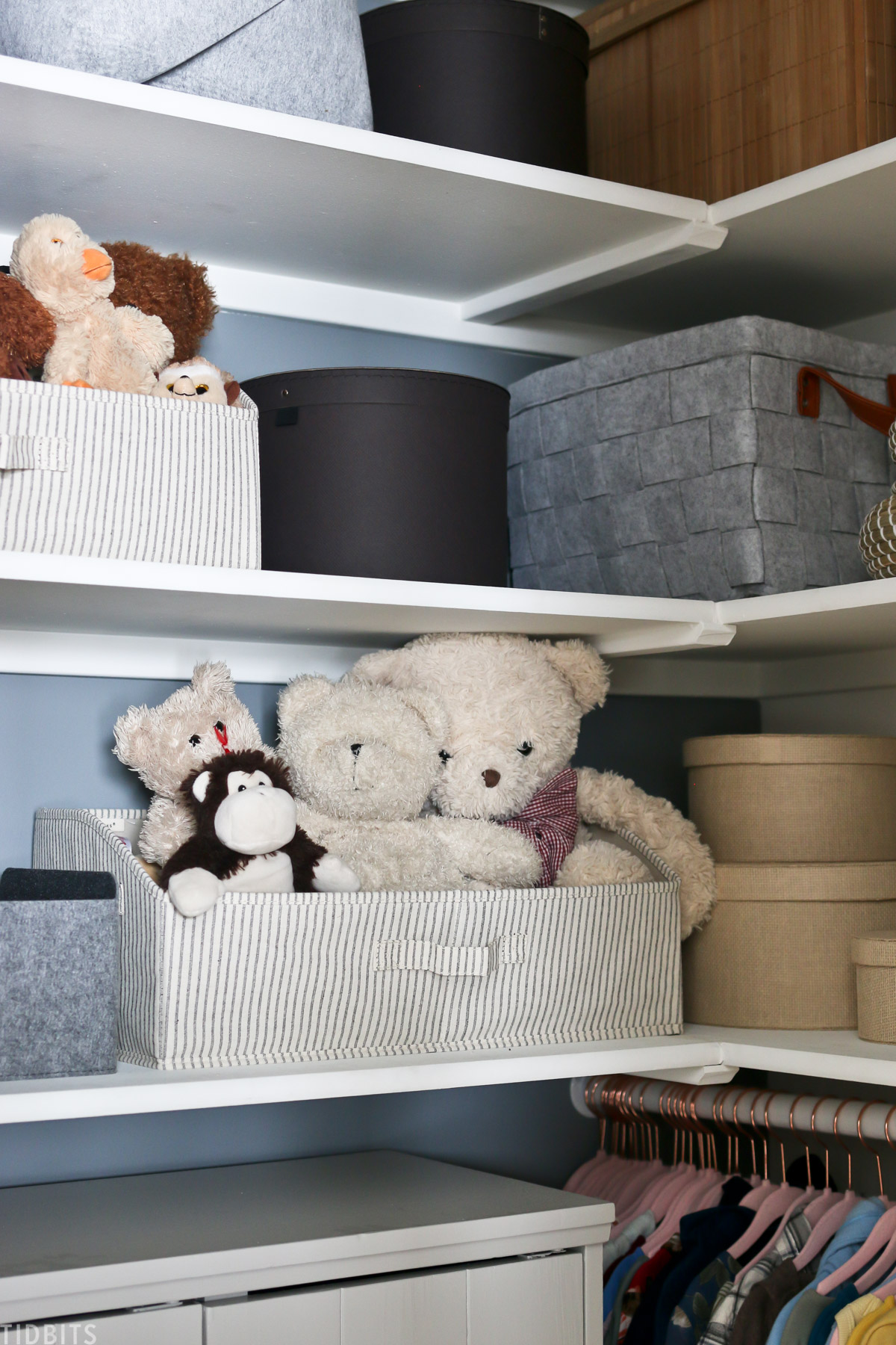 baskets filled with stuffed teddy bears on a shelf within a closet
