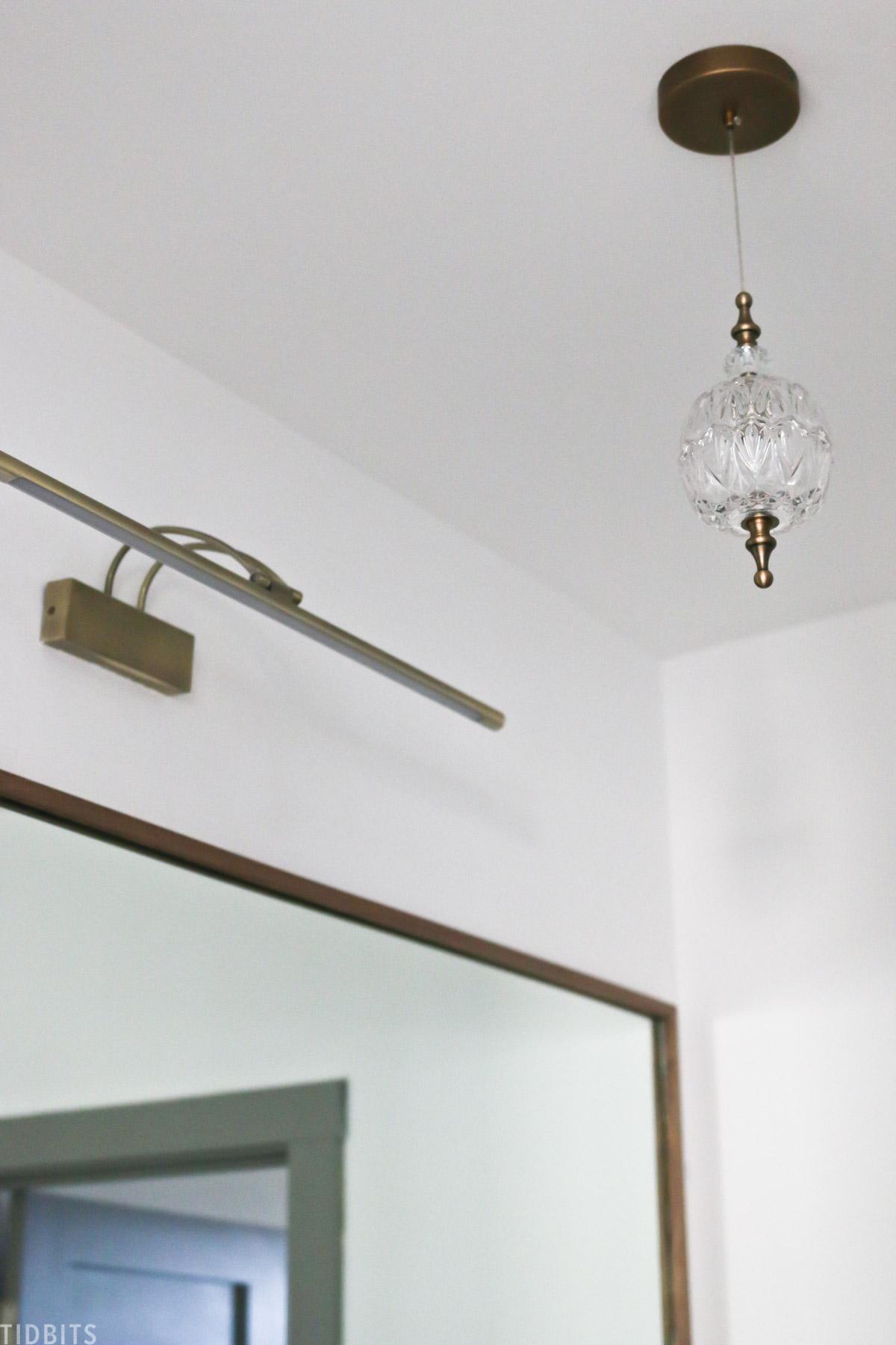 small chandelier hanging in split bathroom