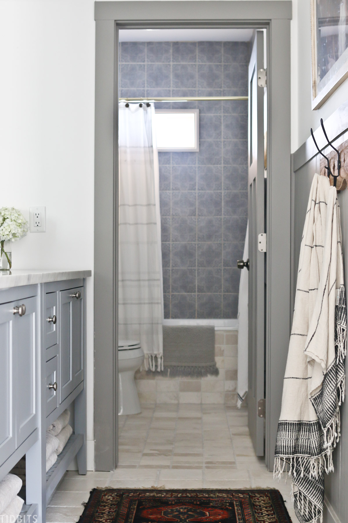 view of doorway in split bathroom that leads to shower and toilet