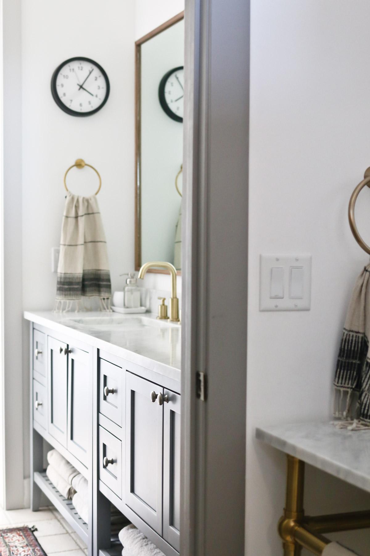 view of sink near toilet and bathroom vanity in split bathroom area