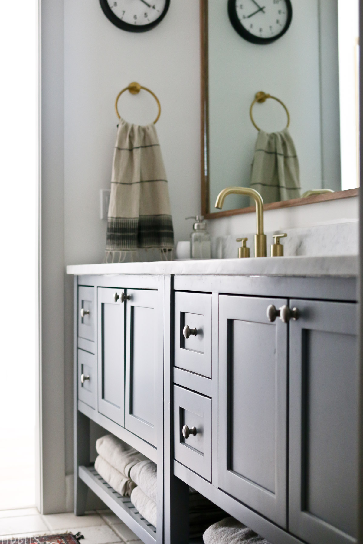 gray colored bathroom vanity with marble