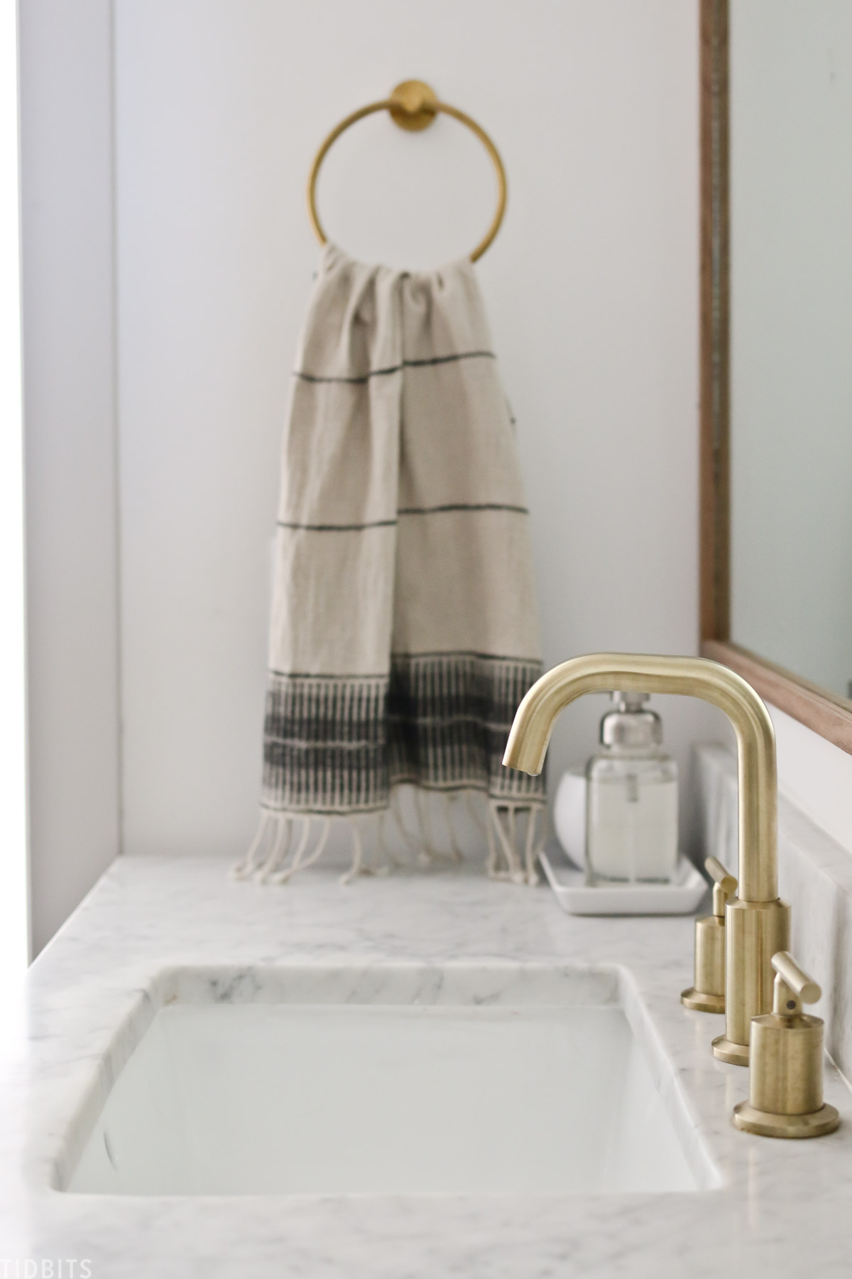 towel hanging from gold colored towel rack