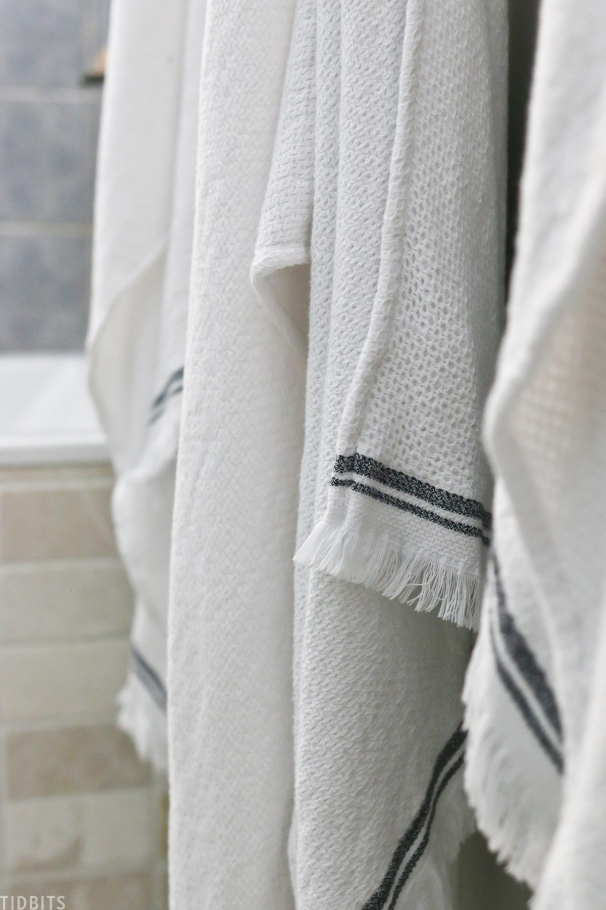 white towels with two gray stripes