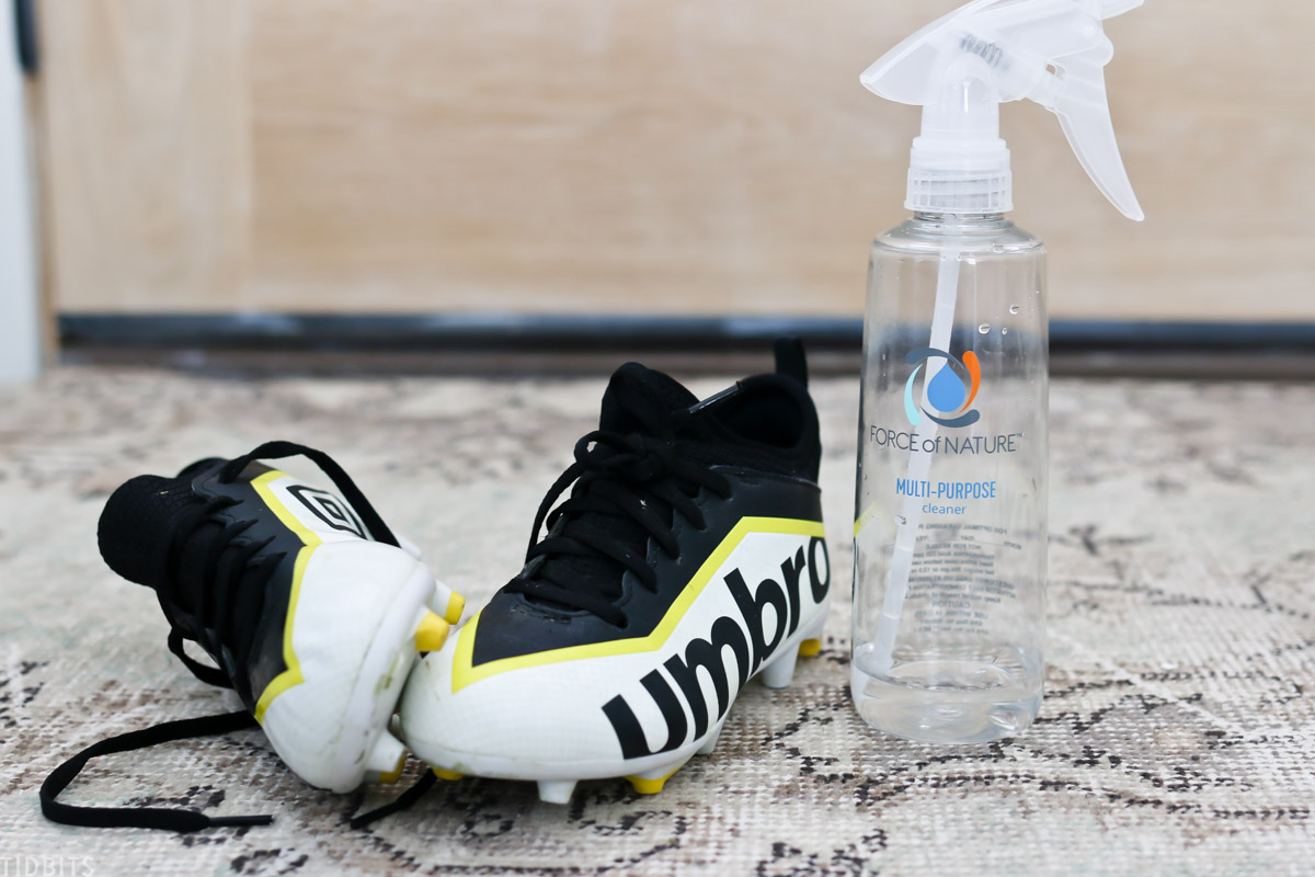 Force of Nature spray bottle next to a pair of shoes
