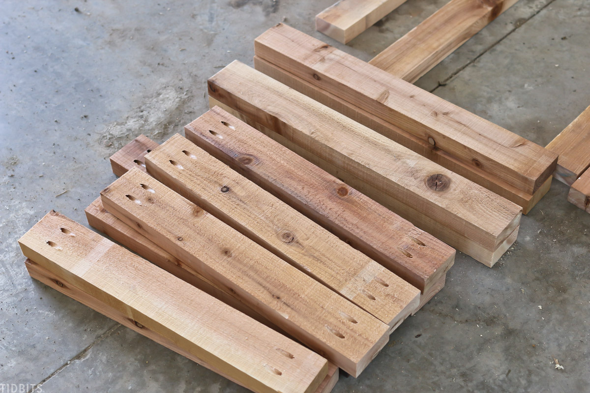 sections of cedar wood laid out on garage floor