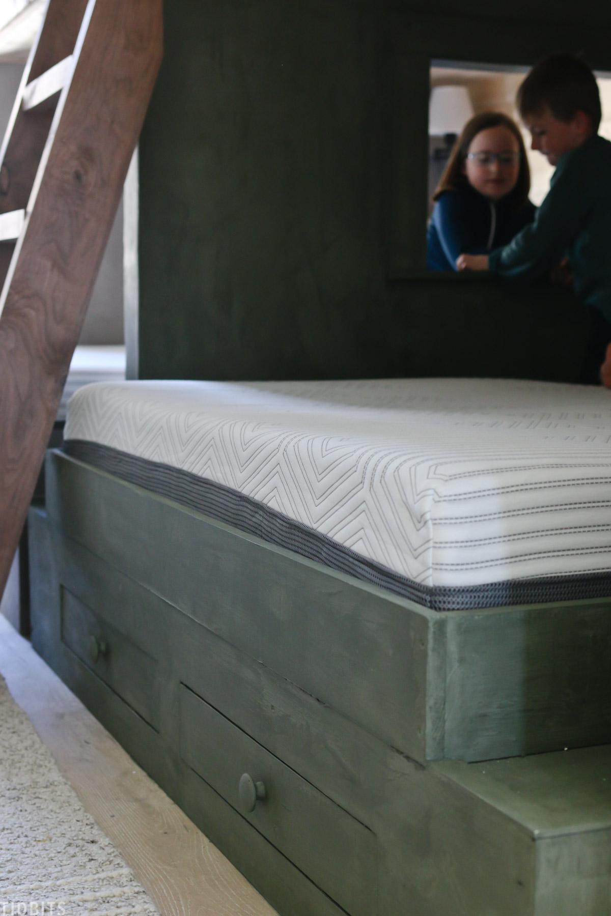 kids platform bed with a memory foam mattress made by Mattress Firm