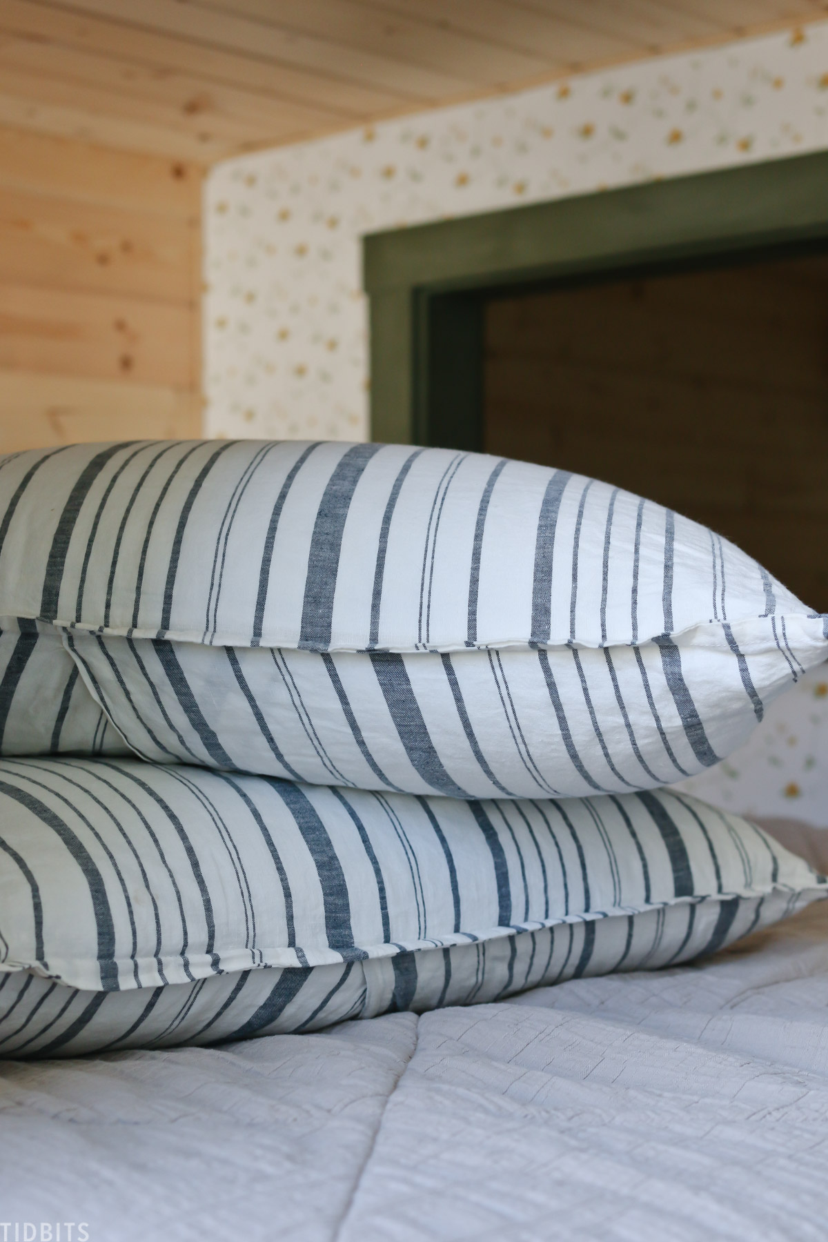 striped linen comforter on two pillows