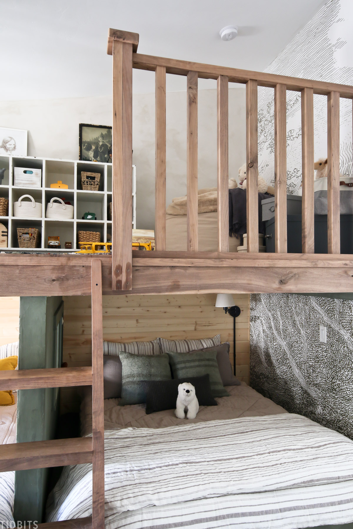 bedroom loft above two beds in a shared kids bedroom