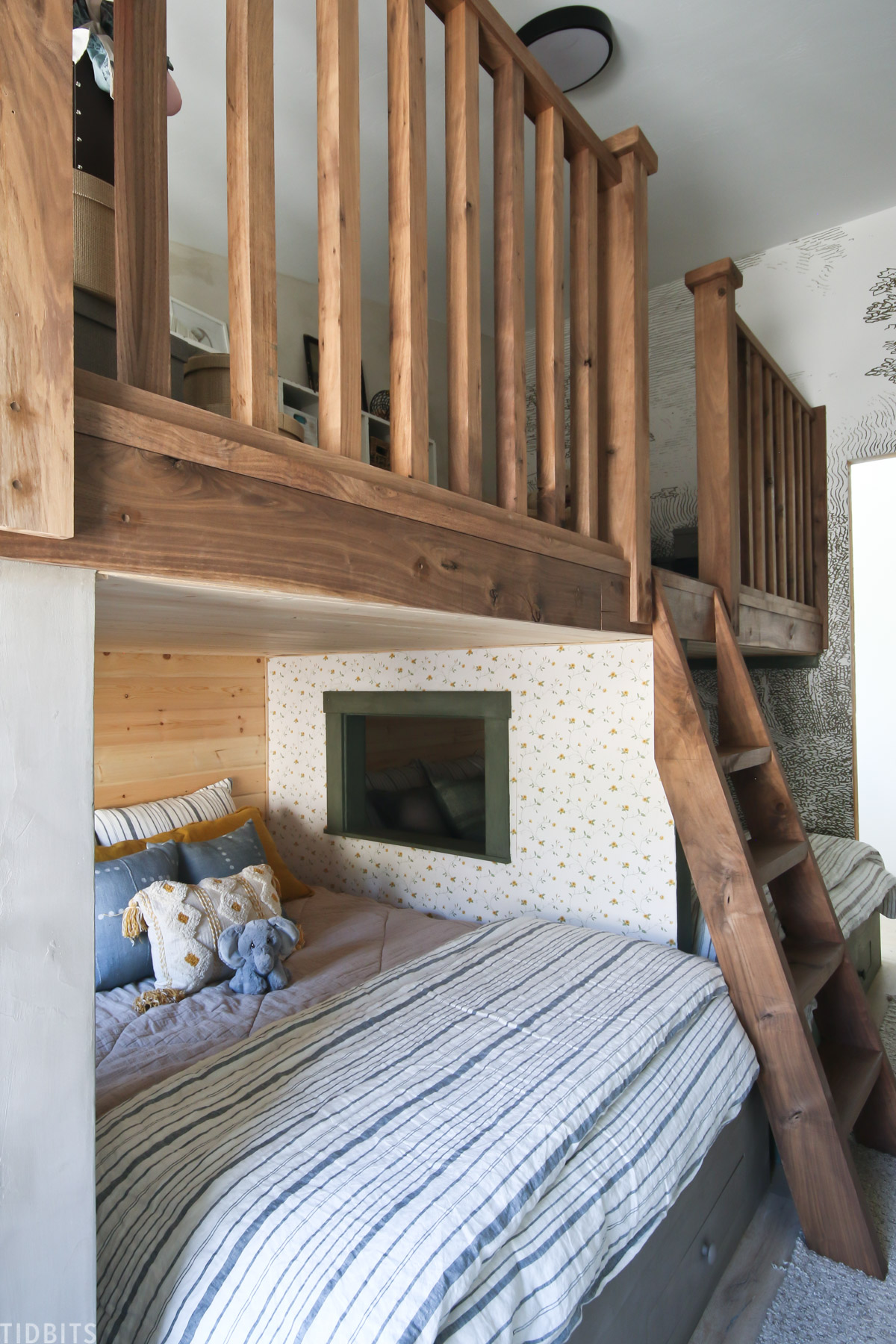 two beds underneath a lot in a shared kids bedroom