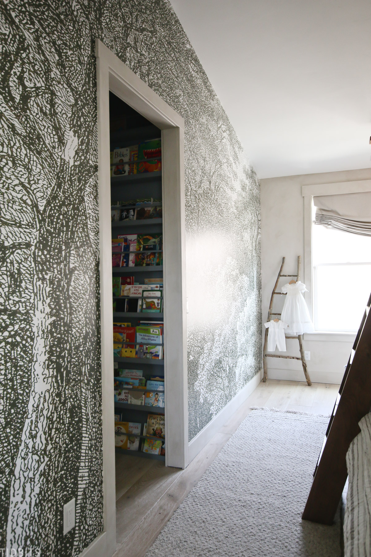 doorway leading to the walk in closet in this shared bedroom for kids