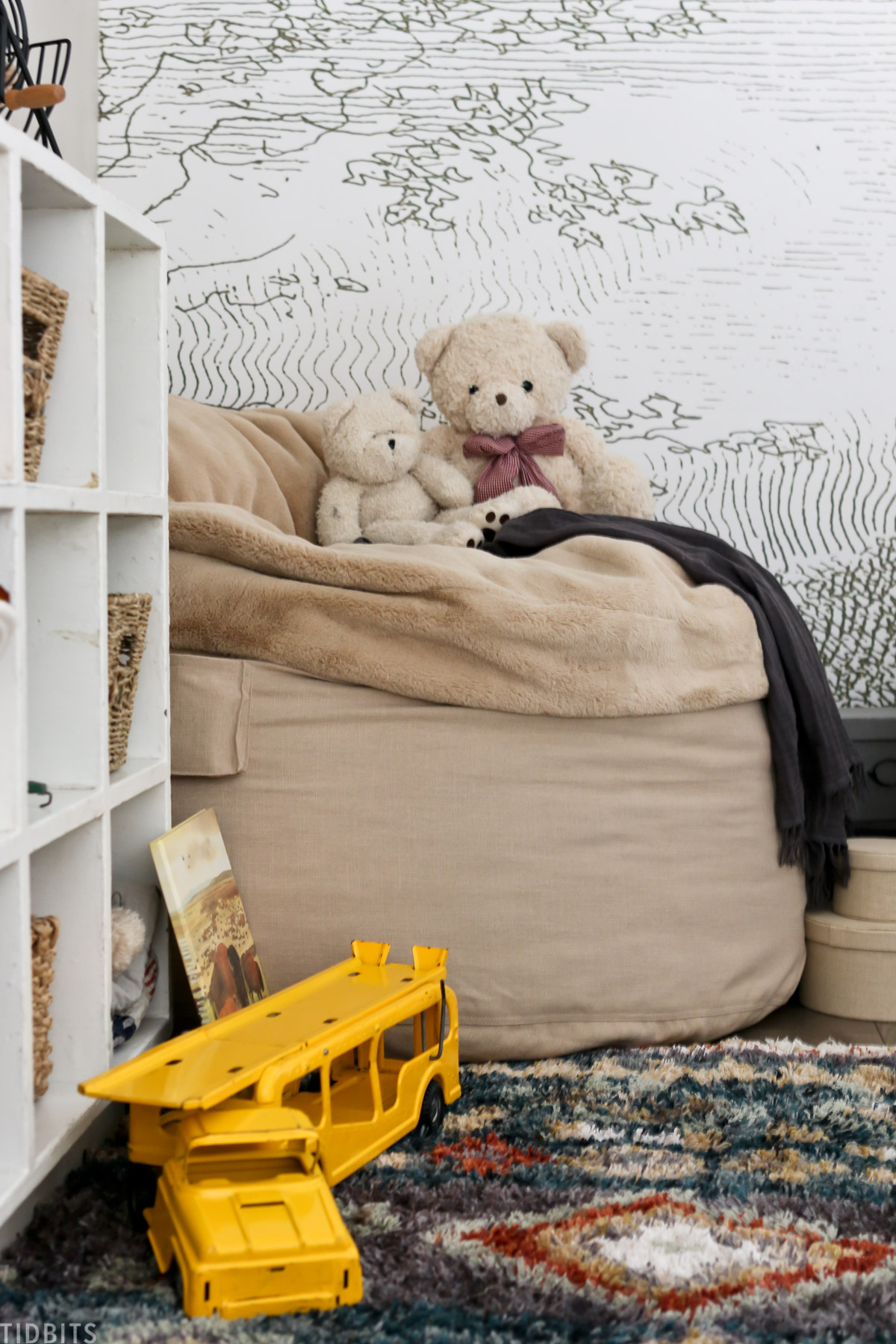 bean bag with teddy bears on top and toy truck next to it