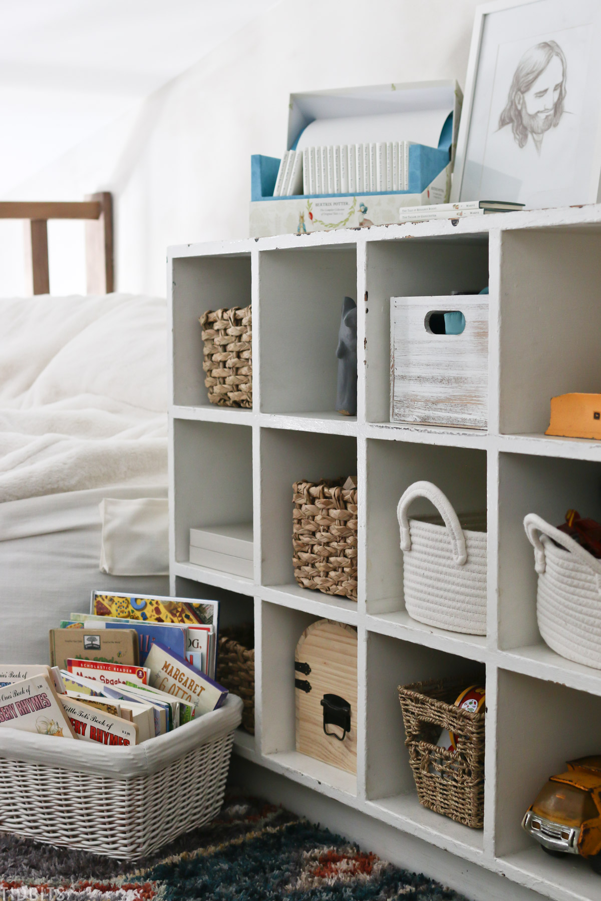 storage cubby with baskets and books on top