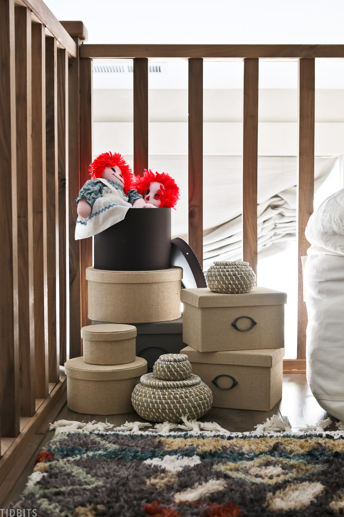 decorative storage baskets placed in the corner of a loft