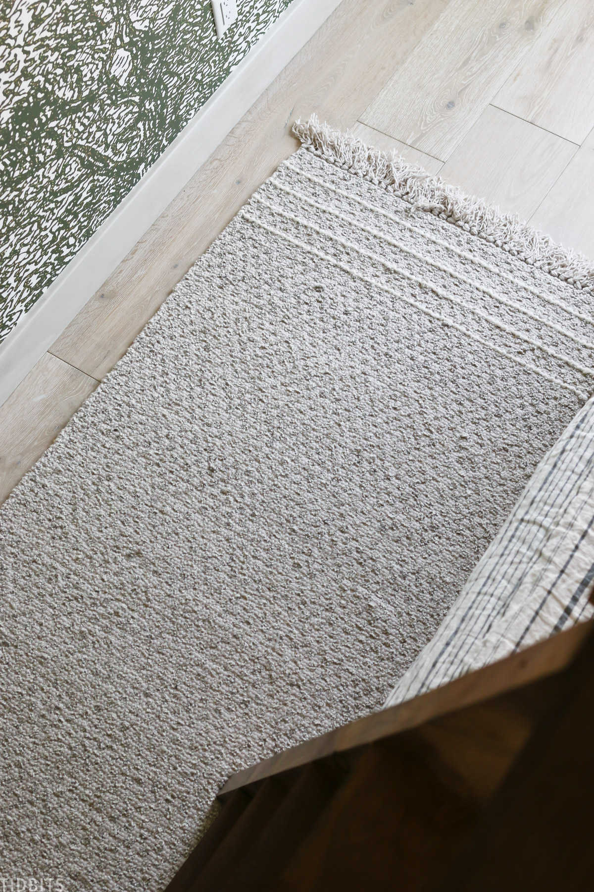 Lazro Fringe Woven Rug laid out on the floor in a kids bedroom