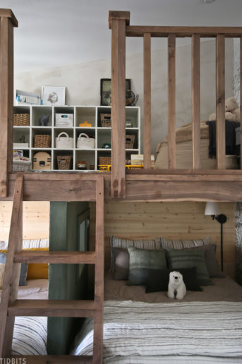 play loft installed above two beds in a shared kids bedroom
